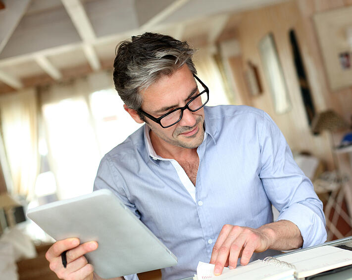 Handsome businessman with eyeglasses working from home